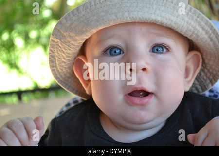 5 Month old blue eyed baby boy shedding a tear - Stock Photo