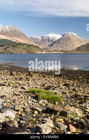 Looking across Loch Leven, in the district of Lochaber , towards Glencoe village and the Glencoe mountains - Stock Photo