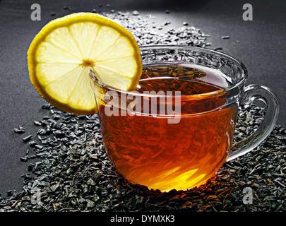 Glass cup of tea with lemon - Stock Photo