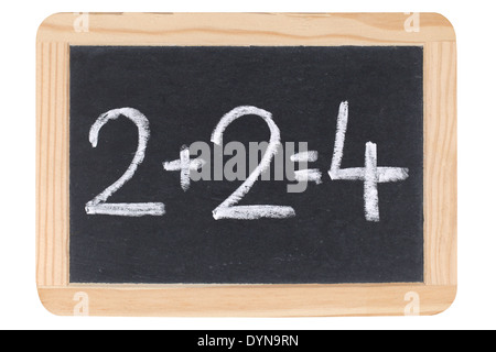 A simple calculation on a blackboard at school - Stock Photo