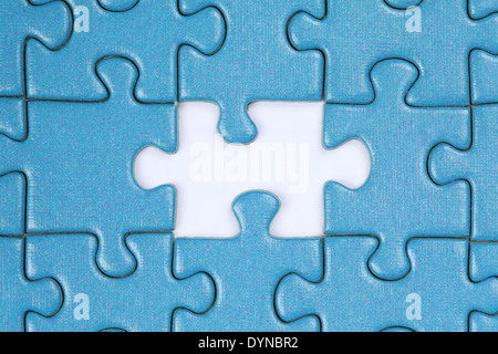 Jigsaw Puzzle with the last missing piece - Stock Photo