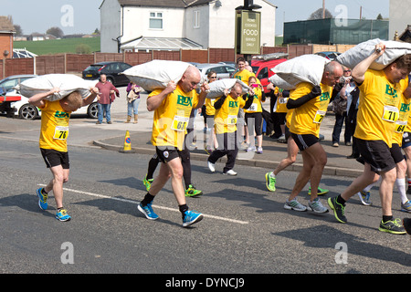 The World Coal Carrying Championship, Gawthorpe, West Yorkshire, Easter Monday 2014.  male contestants at the start - Stock Photo