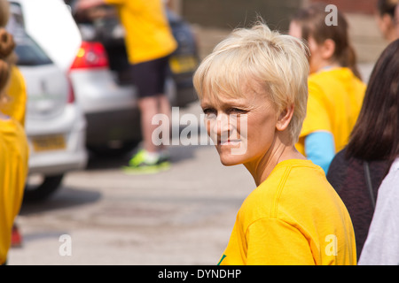 World Coal Carrying Championship, Gawthorpe, West Yorkshire, Easter Monday 2014.  Female contestant at the start - Stock Photo
