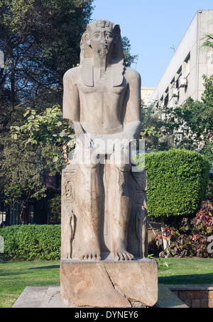 Egyptian Museum of Cairo.A statue of King Ramses II (1303-1202 b.C. XIX° dyn.) in the courtyard of the Museum. - Stock Photo