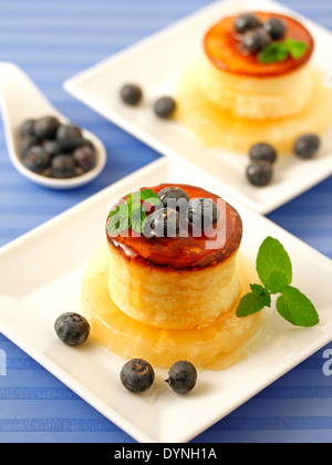 Cheese tart with honey and blueberries. Recipe available. - Stock Photo