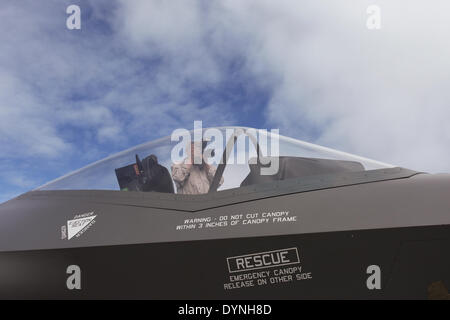 Canberra, Australia. 6th Apr, 2014. A man takes photos of a F-35 model shown at the Canberra Airport Open Day in - Stock Photo