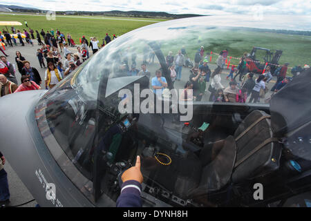 Canberra, Australia. 6th Apr, 2014. People look at a F-35 model shown at the Canberra Airport Open Day in Canberra, - Stock Photo
