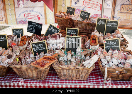 Selection of Salami on a Market Stall in Moelan-Sur-Mer, Brittany France - Stock Photo