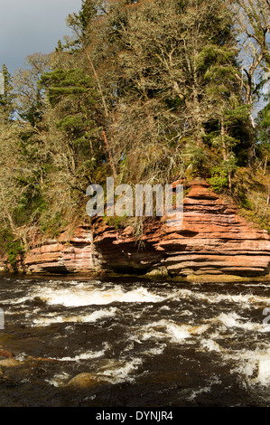 RED CLIFFS AND WHITE WATER RIVER FINDHORN IN EARLY SPRING MORAY SCOTLAND - Stock Photo