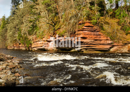 RED SANDSTONE CLIFFS OVER THE RIVER FINDHORN AND WHITE WATER MORAY SCOTLAND - Stock Photo