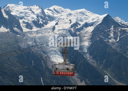 Cable Car from Chamonix to the summit of the Brevent with the Mont Blanc in the background. - Stock Photo
