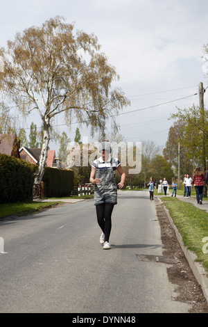 The quirky annual village Tommy Trot Beer Race held Easter Monday at the Laughing Fish Pub in Isfield, East Sussex, - Stock Photo