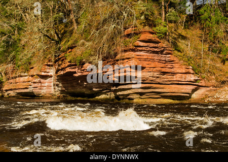 SALMON POOL AT DARNAWAY ON RIVER FINDHORN SCOTLAND WITH RED SANDSTONE CLIFFS AND WHITE WATER - Stock Photo