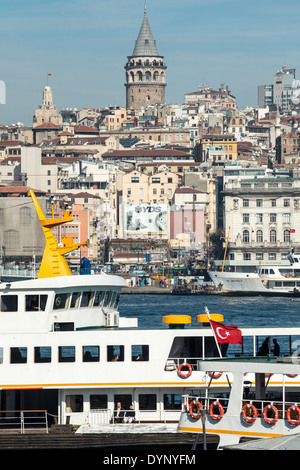 View from Eminonu with ferries on the Golden Horn with Beyoglu and the Galata tower in the background. Istanbul, - Stock Photo