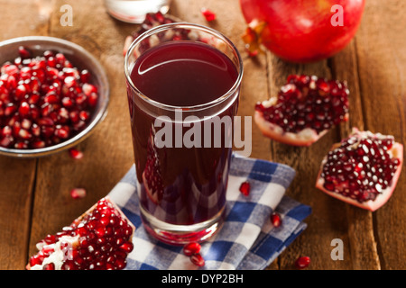 Healthy Organic Pomegranate Juice in a Glass - Stock Photo