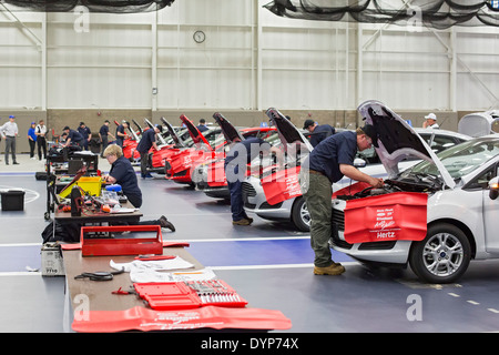 High School Students Participate in Auto Repair Competition - Stock Photo
