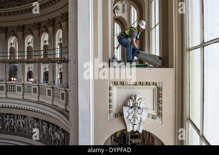 Workers create a scaffold to support a protective canopy inside the Rotunda during the restoration of the US Capitol - Stock Photo