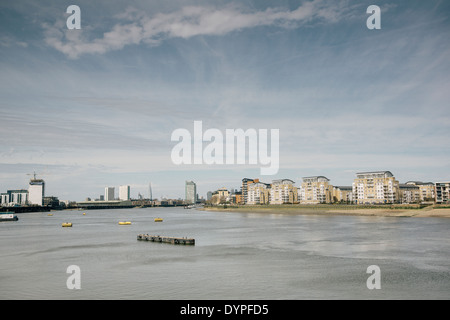 View of the North bank of the river Thames as seen from Greenwich in the city of London, United Kingdom. - Stock Photo