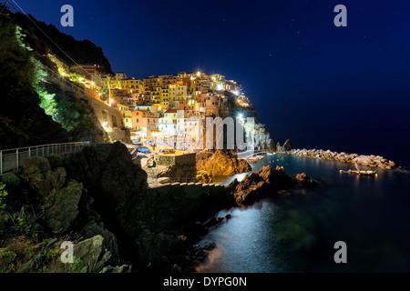 Manarola town at dusk along Cinque Terre, Italy, EU - Stock Photo
