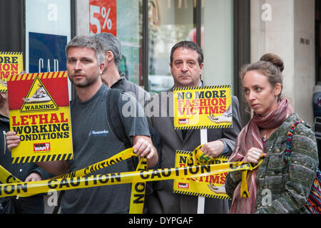 London, UK. 24th April 2014. Comedian, Mark Thomas (centre) joined protesters outside Gap's flagship store in High - Stock Photo