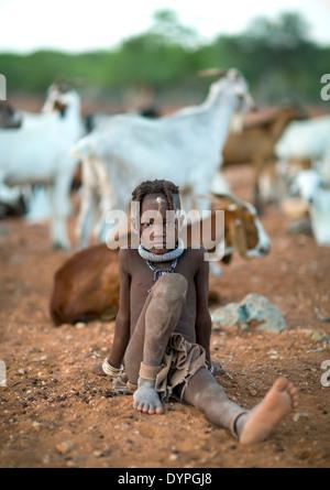 Young Himba Girl With Ethnic Hairstyle, Epupa, Namibia - Stock Photo
