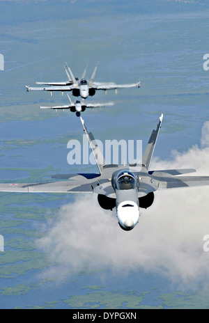 Four US Marine Corp F/A-18 Hornet fighter aircraft fly in formation July 11, 2009 above New Orleans, Louisiana. Stock Photo