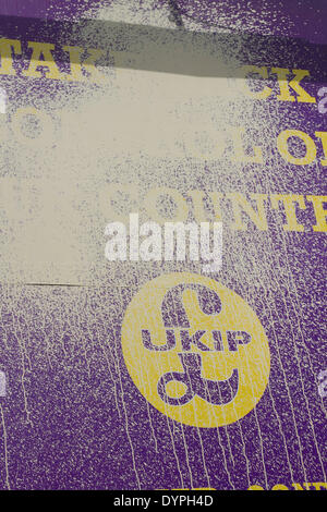 London UK. 24th April 2014. A (UKIP) United Kingdom Independence Party campaign poster has been defaced with paint - Stock Photo
