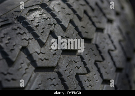 Close-up of tyre / tire showing detail of tread pattern. - Stock Photo