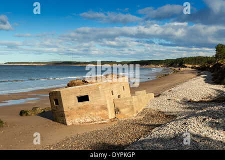 WORLD WAR II PILL BOXES ON THE SAND OF FINDHORN BEACH MORAY SCOTLAND - Stock Photo