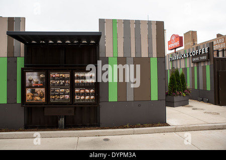 Starbucks Coffee shop built out of recycled shipping containers in Chicago, Illinois USA. Located at the corner of Broadway and Devon the drive-thru only store is part of Starbucks' strategy to develop store concepts from re-purposed materials.