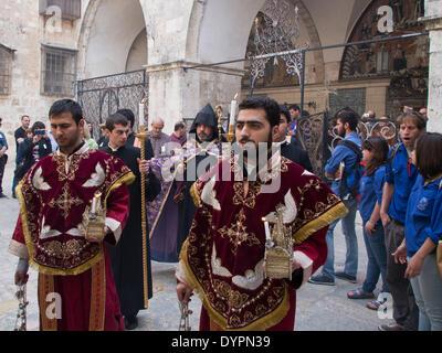 Jerusalem, Israel. 24th Apr, 2014. A ceremonious procession leads the Armenian Patriarch, Archbishop NOURHAN MANOUGIAN - Stock Photo