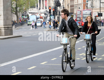 London, England, UK. People on 'Boris Bikes' - Barclays hire cycles - in Whitehall - Stock Photo