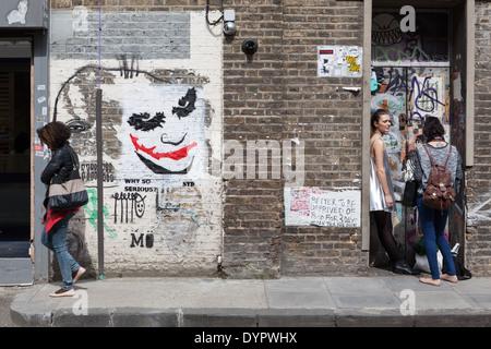 Street art on Fashion Street, in Shoreditch, London. - Stock Photo