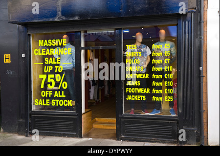 Local clothing store with sale on the High Street Bangor Gwynedd North Wales UK - Stock Photo