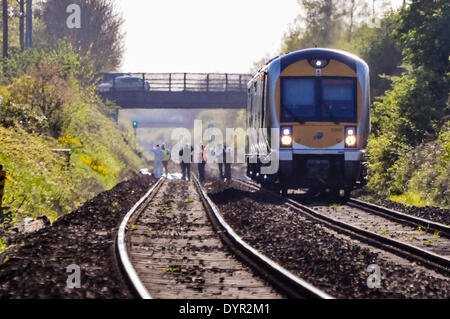 Lurgan, Northern Ireland. 24 Apr 2014 - Police and railway staff gather at the scene on a railway track at the spot - Stock Photo