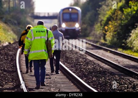 Lurgan, Northern Ireland. 24 Apr 2014 - Three forensic investigators walk along a railway track to the spot where - Stock Photo