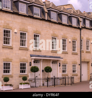 Row of new build stone terraced town houses in Georgian Style, Stamford, Lincolnshire, England, UK - Stock Photo