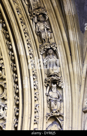 Detail of stone carvings of figures on archivolt of Great North Door, Westminster Abbey, London, England - Stock Photo