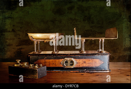 Vintage kitchen scales with brass weights, against old worn out stone wall. - Stock Photo