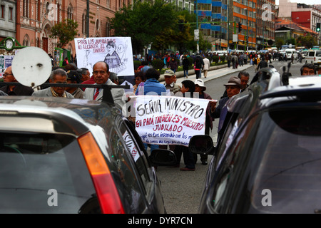 Retired teachers block the road during a protest demanding an increase in their government pension payments, La - Stock Photo