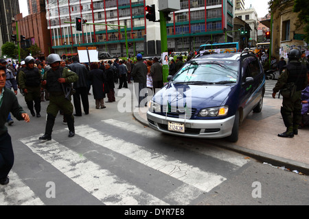 A taxi turns round to avoid a road block during a protest by retired teachers over their pension payments , La Paz, - Stock Photo