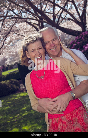 Happy retired couple enjoying spring time outdoors - Stock Photo