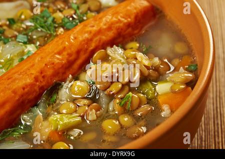 Frankfurter Linsensuppe -German Lentil Soup with sausage.farmhouse kitchen - Stock Photo