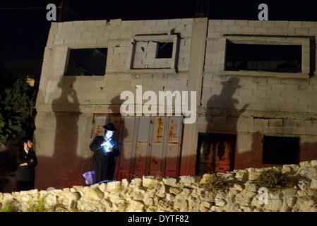 April 24, 2014 - Kifl Hareth, West Bank - KIFL HARETH, WEST BANK - APRIL 24: Ultra-Orthodox Jews pray outside the - Stock Photo