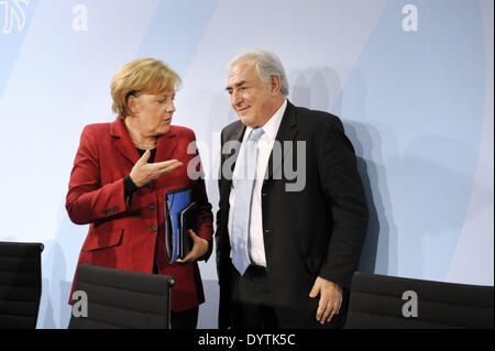 Merkel and Strauss-Kahn - Stock Photo