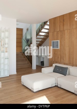 Sofa and ottoman in modern living room, Maison Air et Lumiere, Verrieres-le-Buisson, France - Stock Photo