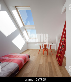 Desk and chair and single bed in modern bedroom, Maison Air et Lumiere, Verrieres-le-Buisson, France - Stock Photo