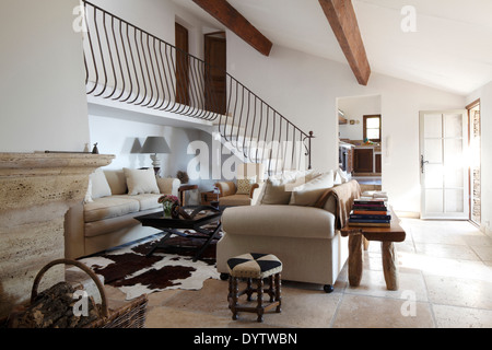 Wide shot of sitting room and stairs, looking towards kitchen, Villa in St Tropez - Stock Photo