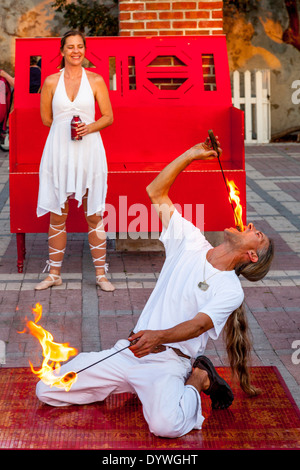 A Fire-Eater Performs At The Sunset Celebration, Mallory Square, Key West, Florida, USA - Stock Photo