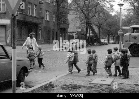 Berlin, DDR, educator about crossing a road with a group of children - Stock Photo
